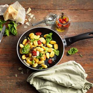GNOCCHI SALAD WITH ROMAINE LETTUCE, TOMATOES AND PARMESAN